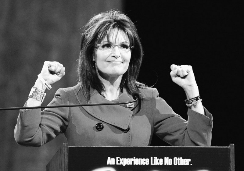 Former Republican vice presidential candidate Sarah Palin gestures as she addresses the National Quartet Convention in Louisville, Ky., Thursday,