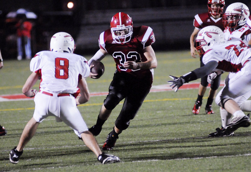 Zach Bean of Scarborough cuts back to the inside Thursday night as he finds a hole against the Sanford defense. Bean rushed for 243 yards on 44 carries and scored both touchdowns in Scarborough's 14-0 victory.