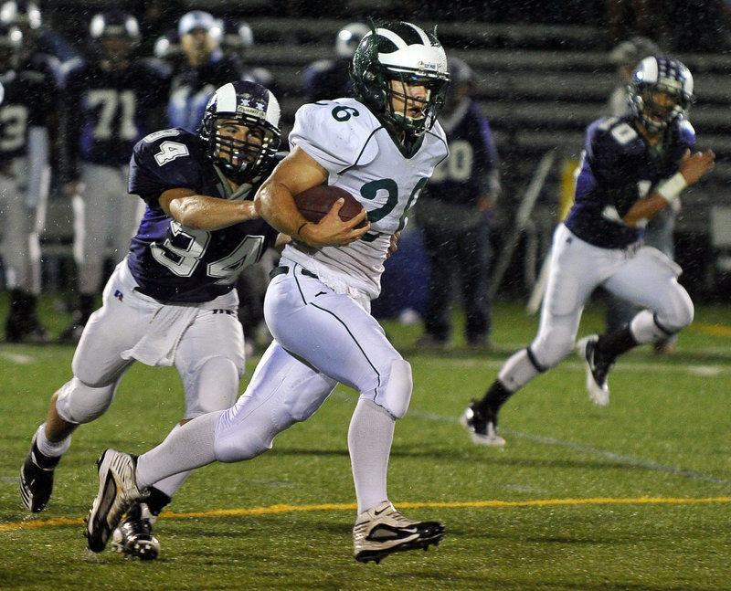 Ethan Thorne breaks away from Deering's Kenny Sweet on his way to a big gain. Thorne had one of five rushing touchdowns for Bonny Eagle.