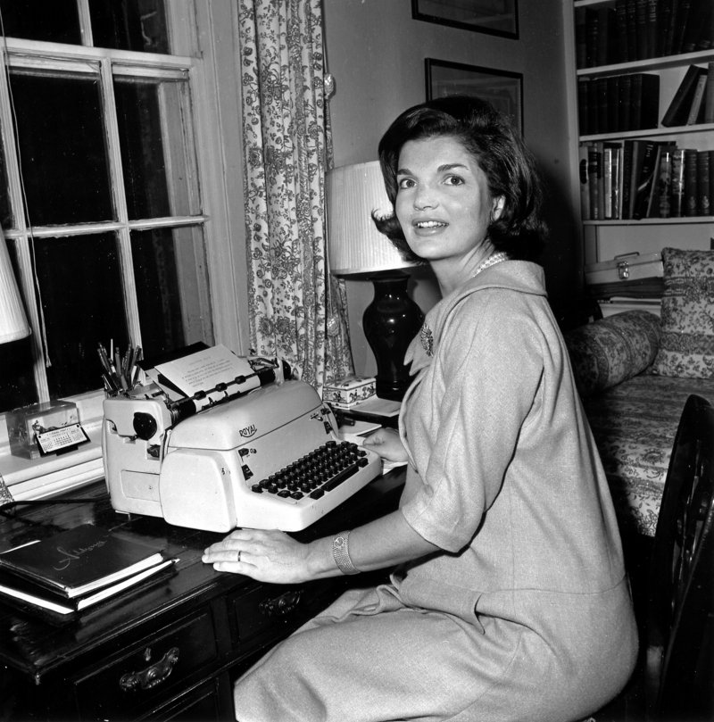 """Jacqueline Kennedy poses at the typewriter where she wrote her weekly """"Candidate's Wife"""" column in this Oct. 5, 1960, photo. The column discussed policies along with personal stories and her advice on everyday matters such as child-rearing and shopping."""