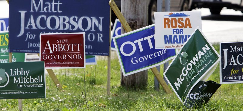 Remember when? Various gubernatorial campaign signs are seen on a corner in Portland on Monday, June 7, the day before Mainers voted for their party candidates in the primary election. Nine candidates saw their bids for the Blaine House end the next night.