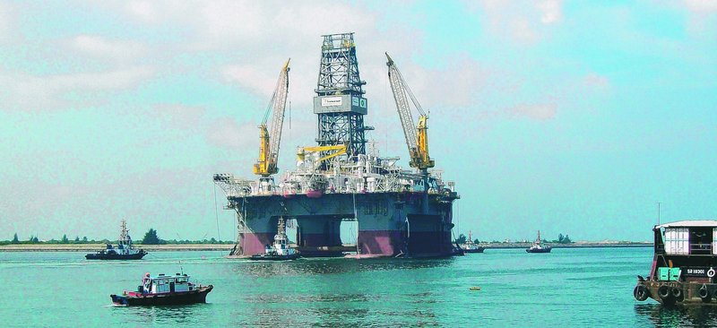 Transocean's Development Driller III is shown from the Louisiana coastline. A relief well drilled nearly 2.5 miles beneath the floor of the Gulf of Mexico intersected BP's blown-out well late Thursday, a prelude to plugging it completely. The final seal should happen today.