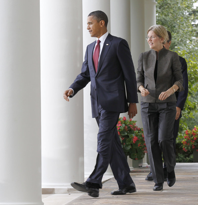 President Obama walks in front of Elizabeth Warren on his way to announce that she will set up the new Bureau of Consumer Financial Protection.