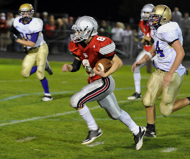 South Portland quarterback Tommy Ellis outruns the Cheverus defense to score on a 30-yard run in the first half Friday night at South Portland. Ellis led the Red Riots in rushing with 92 yards. Cheverus won, 45-21.