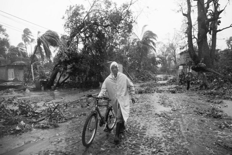 A man walks his bicycle on a street littered with debris after the passage of Hurricane Karl in La Antigua in the Mexican state of Veracruz on Friday. Karl, which hit the Gulf Coast near Veracruz with winds of 115 mph, dissipated today.
