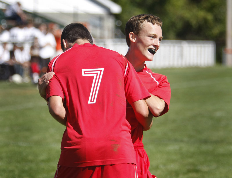 Will Bushey, right, of South Portland celebrates with Nemanja Kaurin in the second half after Kaurin scored the third goal of the game for the Red Riots at Biddeford.