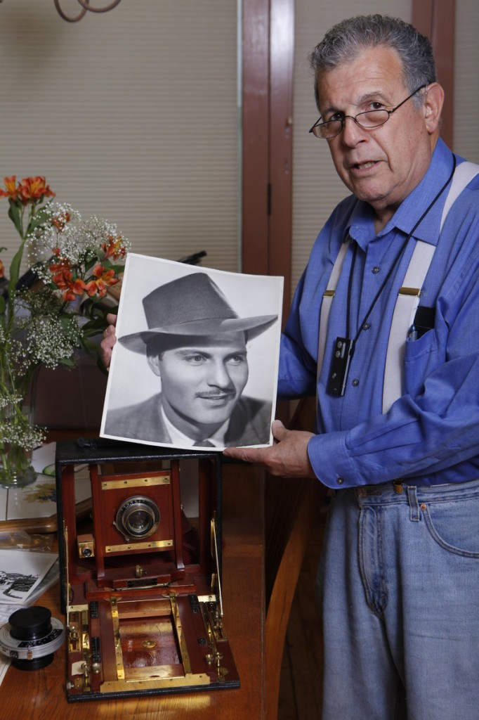 Historian Loren Latker poses with his collection of photographic memorabilia of author Raymond Chandler, creator of the detective Philip Marlowe, at his home in Los Angeles. The remains of the writer and his wife will be reunited on Valentine's Day next year.