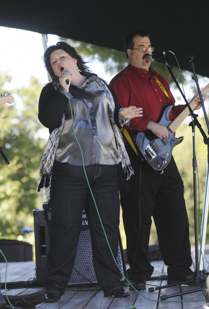 Mary Bergey leads the blues band Rattleboxx through a number at L.L. Bean's Discovery Park.