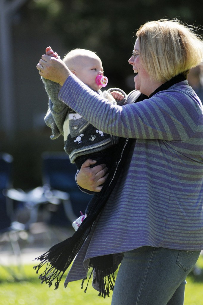 Laura Perkins of Warren dances with her 11-month-old daughter Farren on Saturday during Freeport's 12th annual Fall in the Village Art & Music Festival.