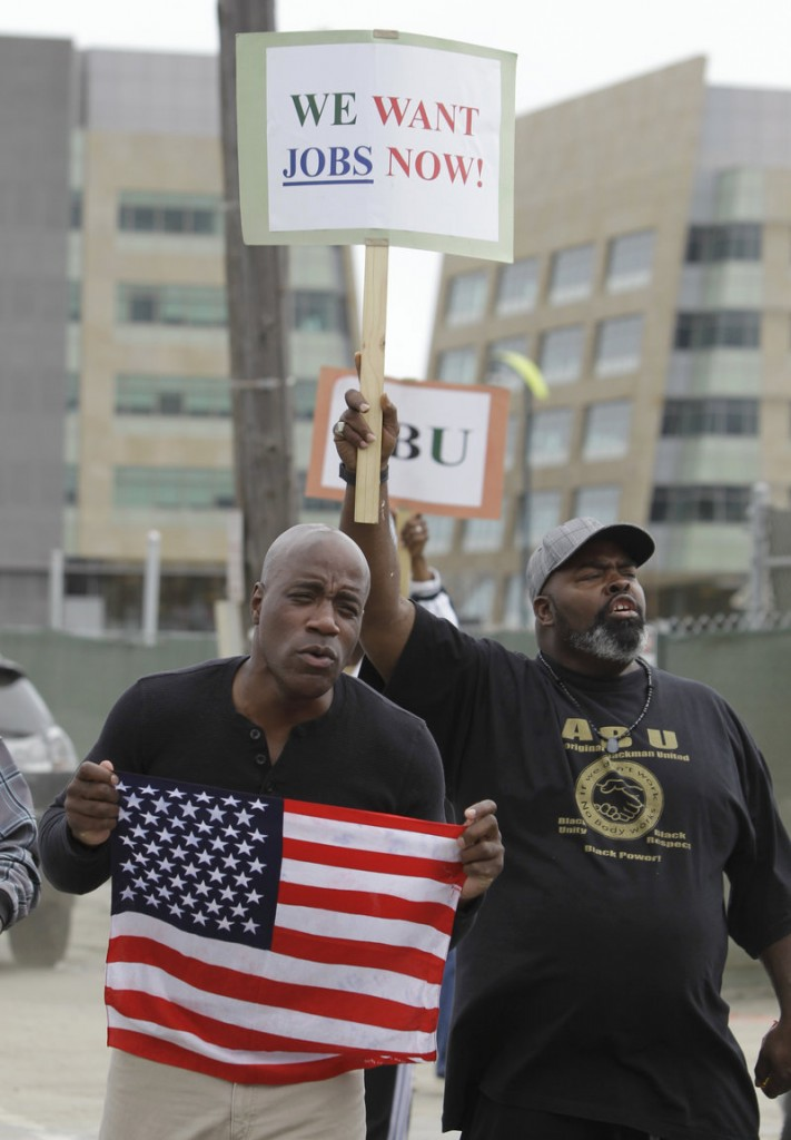 Alex Prince, who is unemployed, holds a sign demanding work as Mike Jones, also jobless, holds an American flag during a rally by workers outside a construction zone in San Francisco last week. The high jobless rate has overshadowed many of Congress' accomplishments.