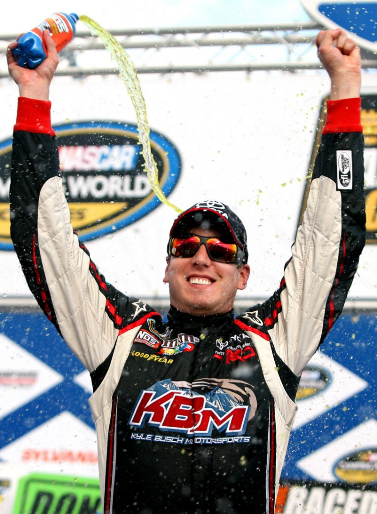 Kyle Busch celebrates after his 80th career NASCAR victory in Saturday's truck series at New Hampshire Motor Speedway.