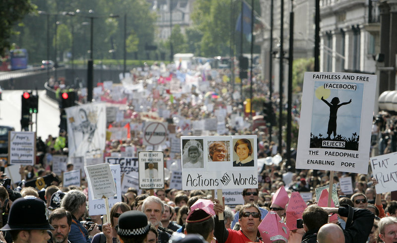 Protesters against Pope Benedict XVI's state visit to Britain march in central London on Saturday. The pope is on a four-day visit, the first-ever state visit by a Pope to Britain.