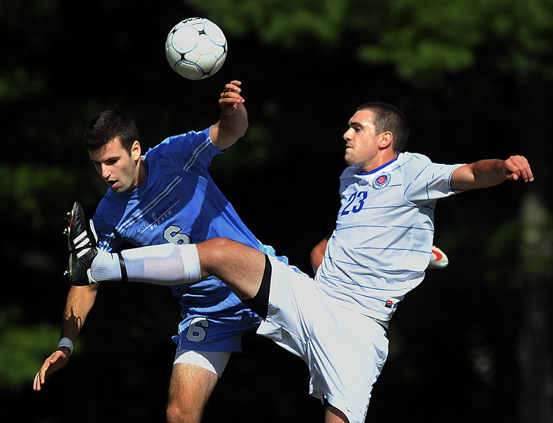 Matt Barlion, right, of St. Joseph's kicks the ball away from Adam Luciano of Lasell, which took charge by scoring its three goals in a six-minute span in the second half.