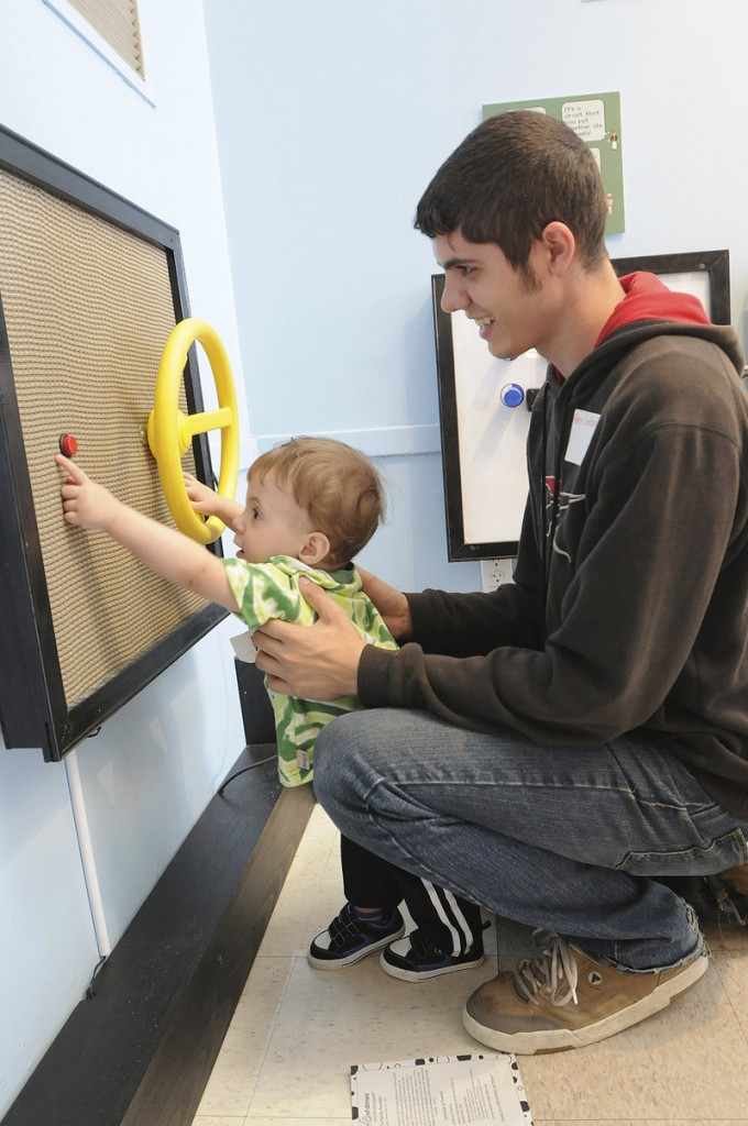 Hayden Inman, 14 months old, and his father, Alex LeBeau of Waterville, play at the Children's Museum and Theatre of Maine in Portland at the NICU reunion.