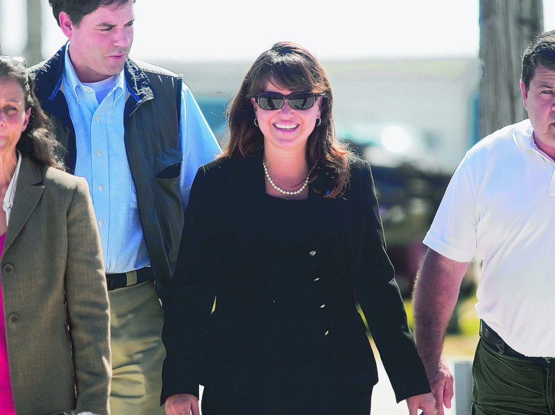 Delaware Senate candidate Christine O'Donnell arrives at a GOP picnic Sunday.