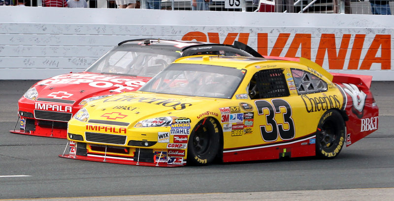 Tony Stewart, left, and Clint Bowyer fight for the lead Sunday in the NASCAR Sprint Cup Sylvania 300 at New Hampshire Motor Speedway in Loudon, N.H. With the win, Bowyer is 35 points behind leader Denny Hamlin.