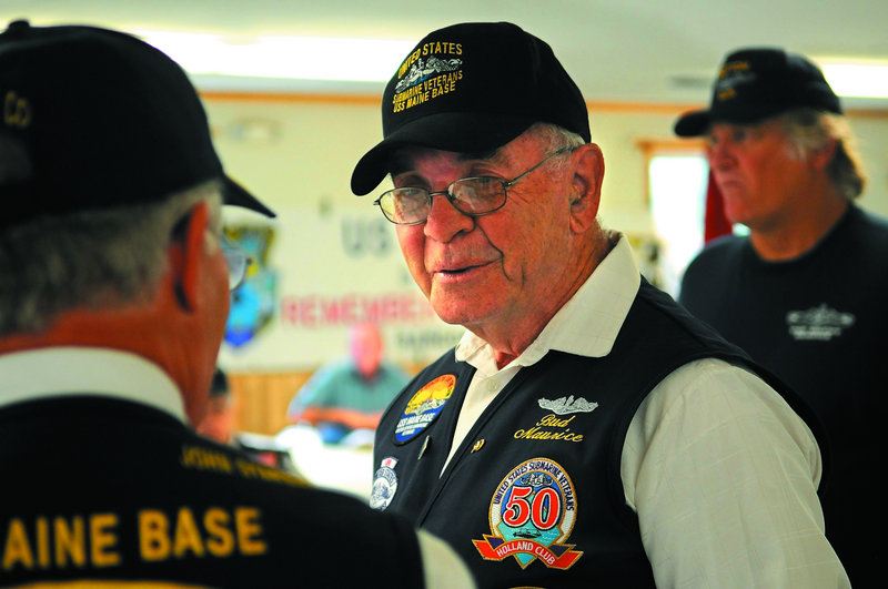 "Maurice ""Bud"" Scribner Jr. was inducted Sunday into the Holland Club, a group of veteran submariners."