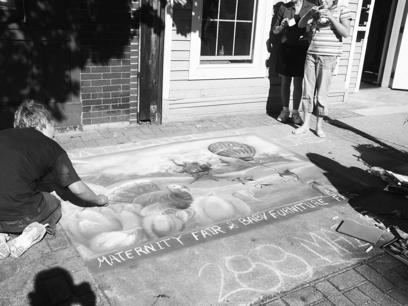 Amy Cote puts the finishing touches on a chalk creation during last year's Chalk on the Walk event in Biddeford.