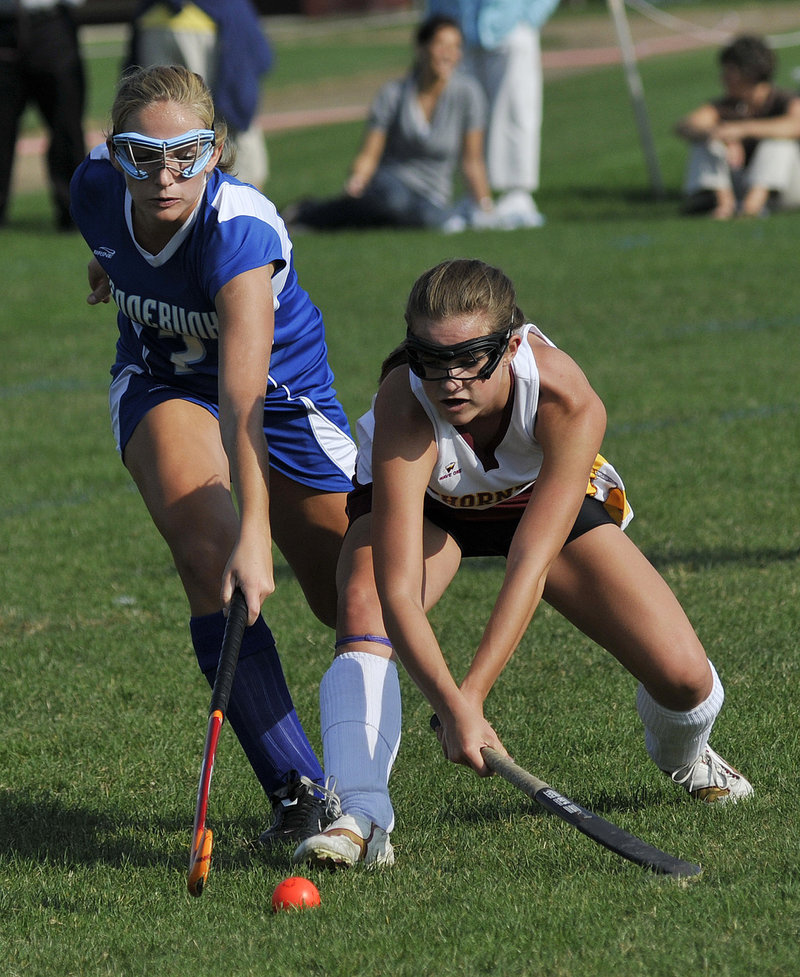 Cheyenne Knox, left, of Kennebunk and Thornton Academy's Nichole Moore try to control the ball. Knox scored the only goal of the first half.
