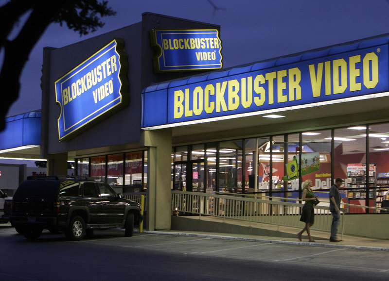 Customers enter a Blockbuster video store in Dallas in 2006. For the company to survive, its new owners will have to come up with an antidote to the dual threats posed by Netflix and video vending machine operator Redbox.