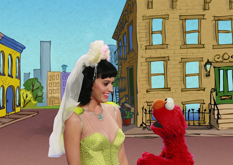 "Singer Katy Perry performs with Elmo in a music video about opposites called ""Hot N Cold"" on ""Sesame Street."""