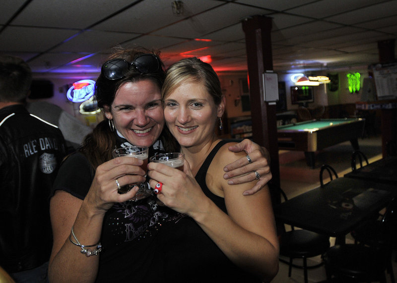Patrons Norma West, left, of Saco and Jaime Reed of Buxton enjoy a drink at the Buxton Tavern during a recent Ladies' Night.