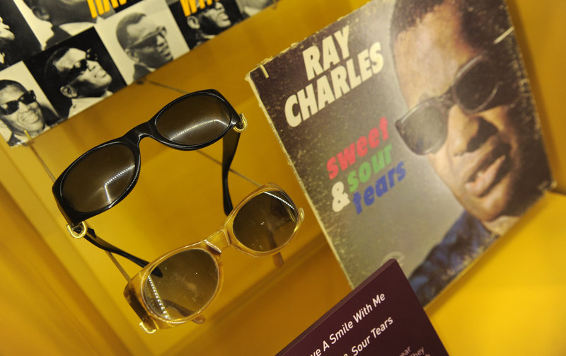 Ray Charles' signature sunglasses are on display at the library, which opened Thursday.