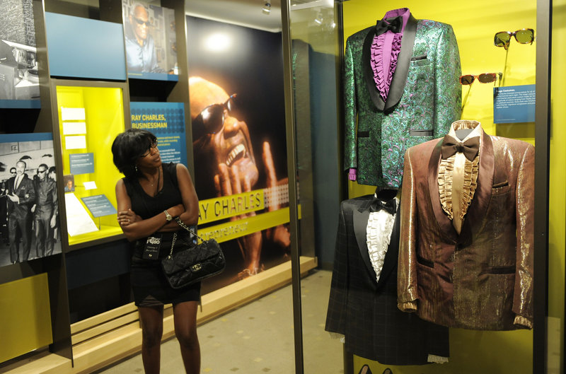 A visitor checks out a display at the Ray Charles library in South Los Angeles.