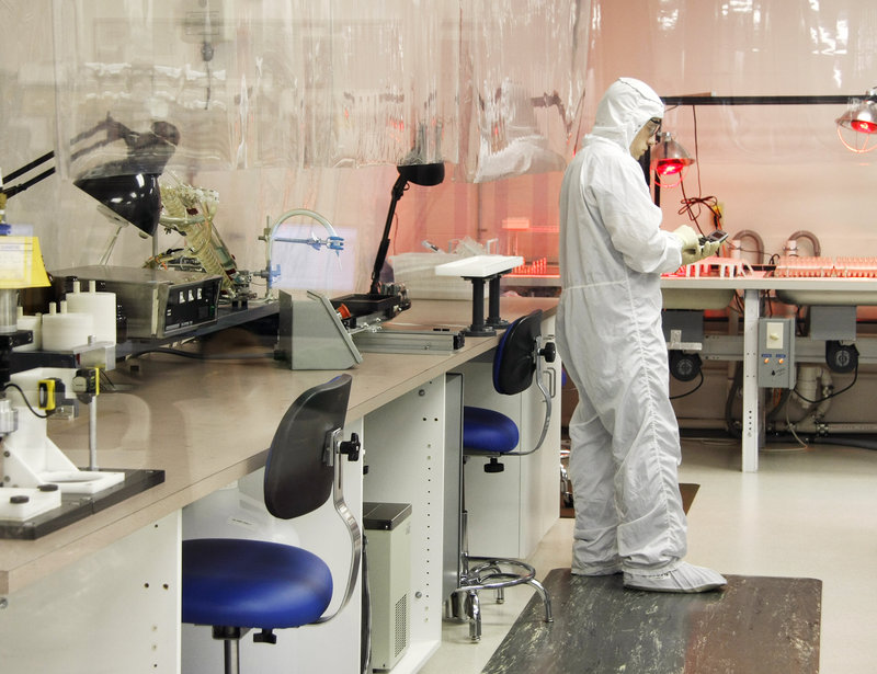 Shawn Willey, a production supervisor, takes inventory in the clean room, which is fed filtered air and entered only by workers wearing head-to-toe coveralls.