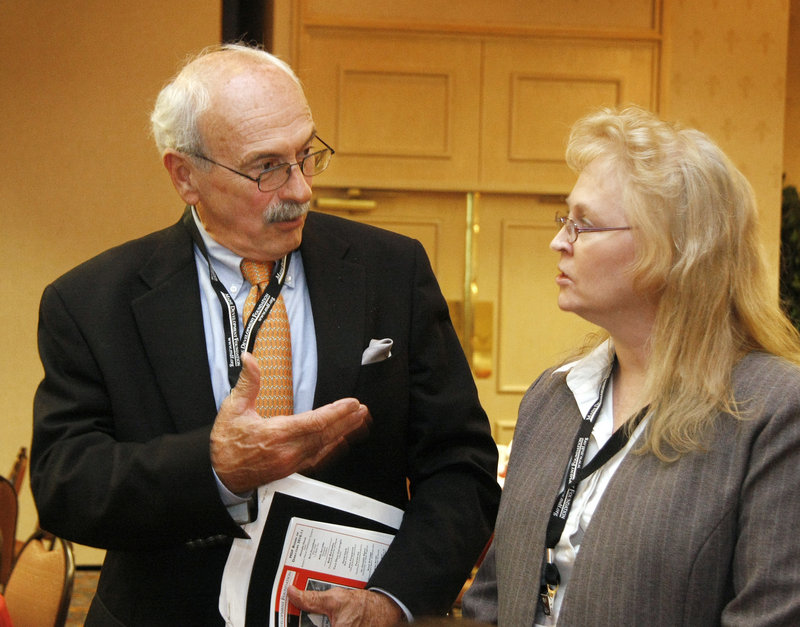 This is a two-line cutline that Jill Brady/Staff Photographer:Jim Day and Terry Ann Stevens chat at the Maine Development Foundations 32nd Annual Meeting Friday, September 24, 2010 at the Holiday Inn By The Bay in Portland.