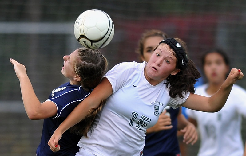 Caroline Kuliga, left, of Traip Academy and Waynflete's Ella Millard collide going for a header Friday during a Western Maine Conference girls' soccer game. Millard had two goals and an assist in the Flyers' 5-0 victory.