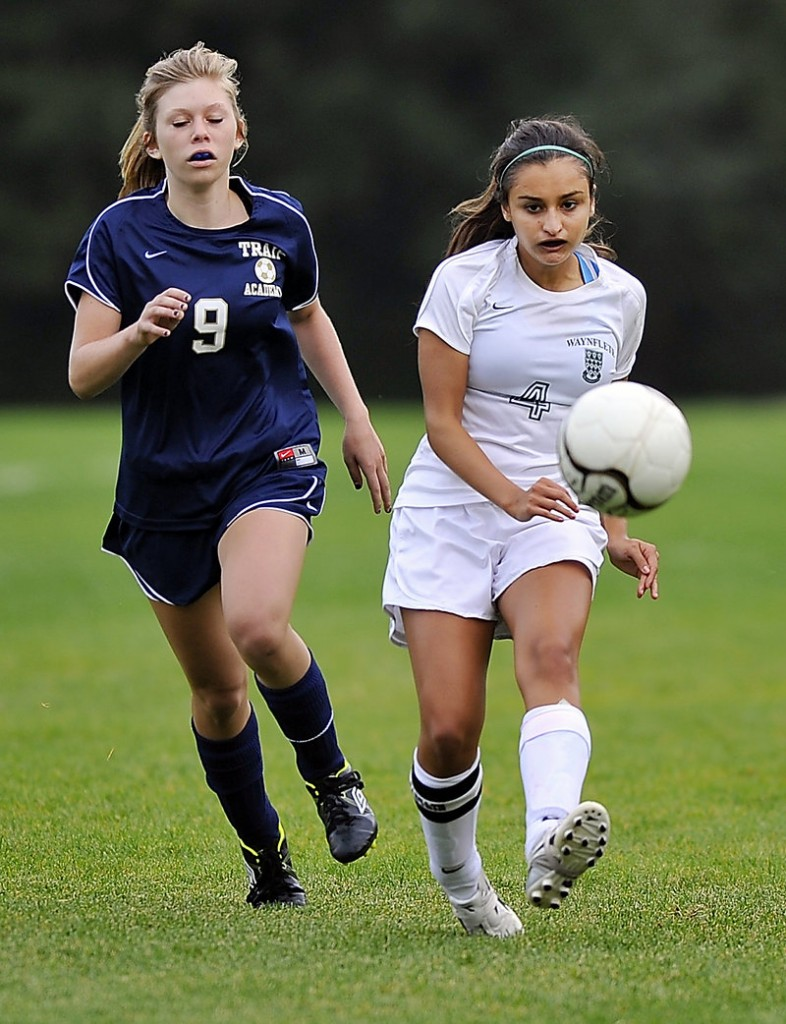 Morgane Gaudissart, left, of Traip Academy and Elena Britos of Waynflete try to catch up with a loose ball. Waynflete improved to 3-2 with the shutout.