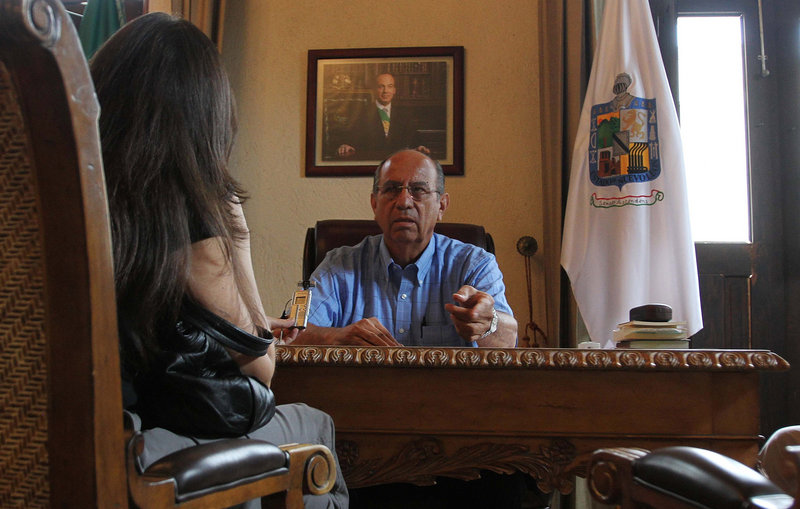 Bladimiro Montalvo, mayor of the town of Santiago in northeastern Mexico, talks with a reporter at his office earlier this month. Authorities say Montalvo's predecessor was kidnapped and shot to death last month by his own police officers.