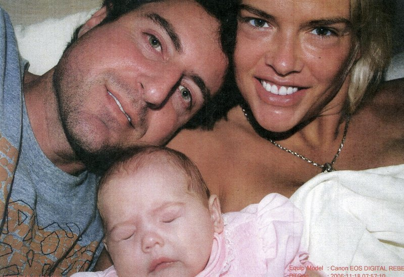 This photo of Anna Nicole Smith with daughter Dannielynn and Howard K. Stern was shown to jurors.