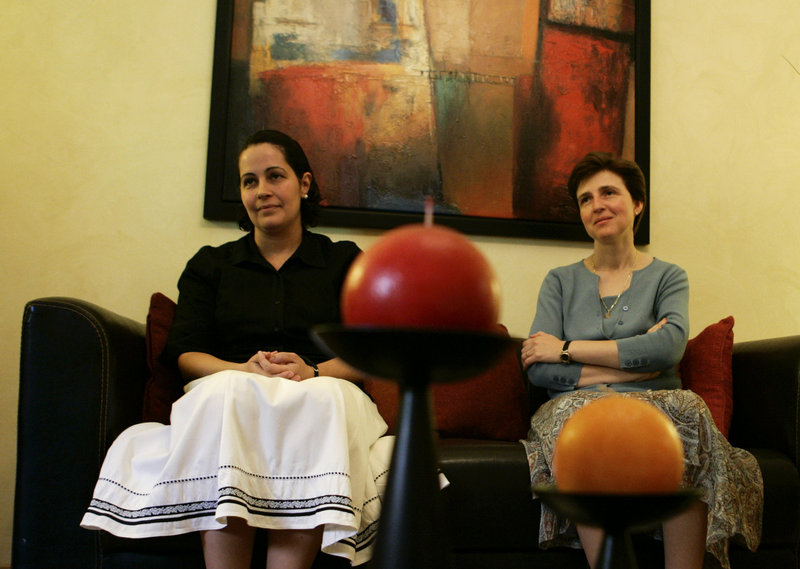 Silvia Vernudez, 37, of Venezuela, left, and Marcela De Maria y Campos, 38, of Mexico, shown during an interview in Rome in June, are lay members of the now-disgraced Legionaries of Christ order who dedicate their lives to the Catholic Church.