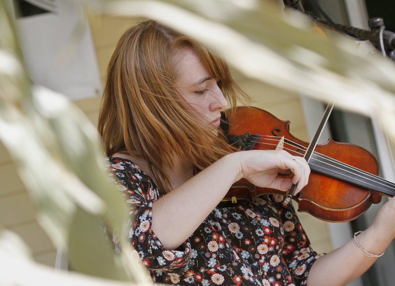Isa Burke of South Berwick fiddles a tune.