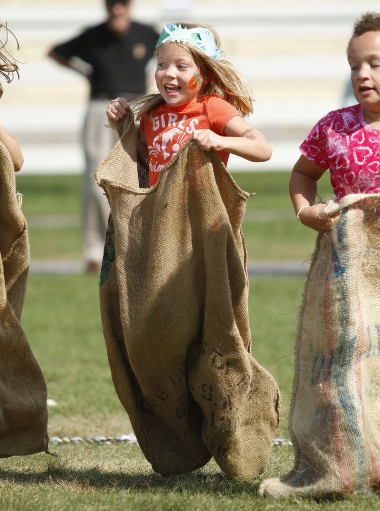 Louise Roper, 4, of Kennebunk bounces through a potato-sack race.