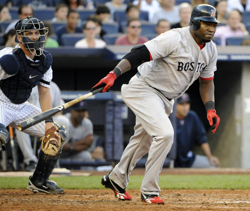 David Ortiz follows through on an RBI single as Yankees catcher Francisco Cervelli looks on during the third inning of Boston's 7-3 win Saturday at Yankee Stadium in New York.
