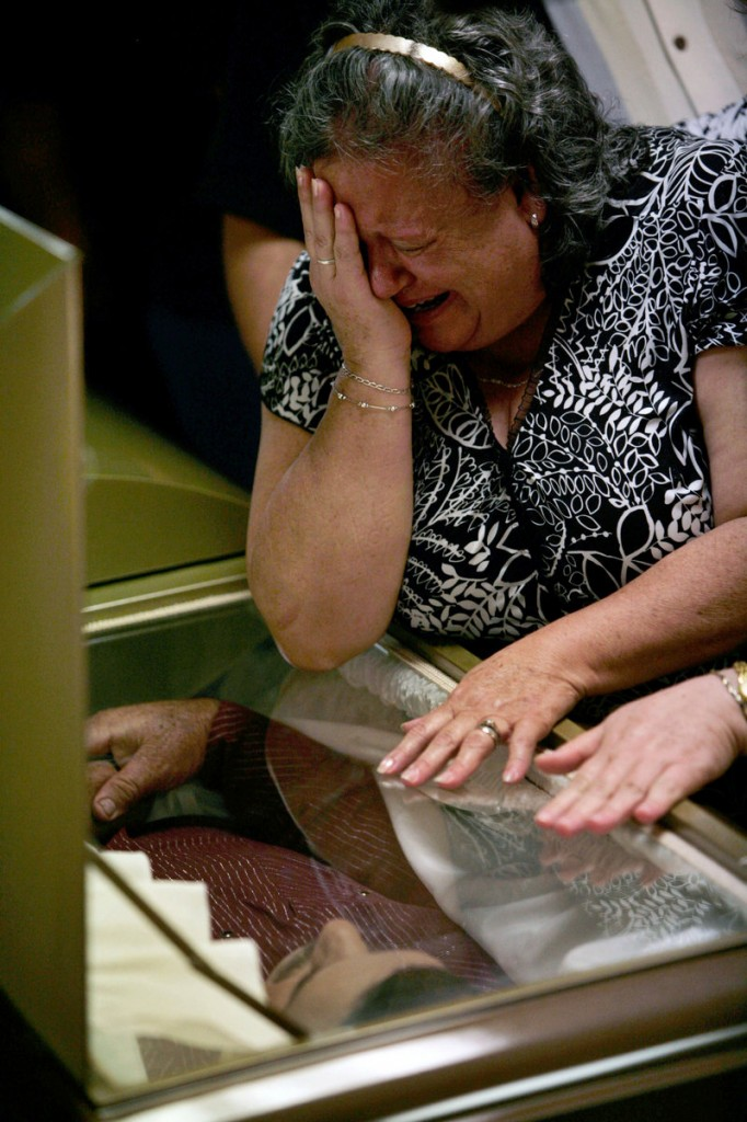A relative of Prisciliano Rodriguez Salinas, late mayor of the town of Doctor Gonzalez, cries Saturday during his wake in Nuevo Leon state, northern Mexico. Rodriguez Salinas was shot to death Thursday by unknown gunmen.