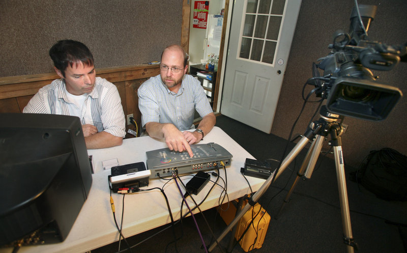Reporter Ray Routhier, right, changes camera views with station manager Patrick Bonsant at Saco River Community Television in Hollis. The public access station serves six towns.