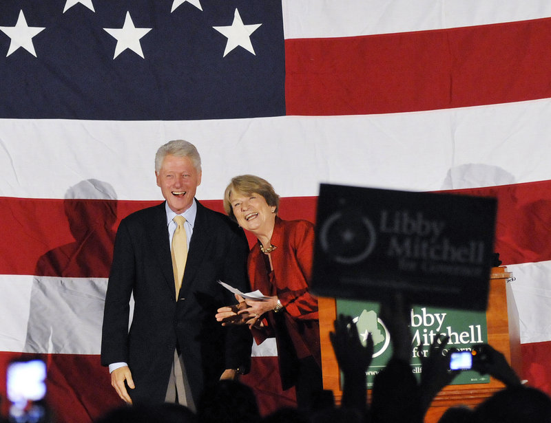"Former President Bill Clinton shares the stage with Democratic gubernatorial candidate Elizabeth ""Libby"" Mitchell at Southern Maine Community College in South Portland on Sunday evening."