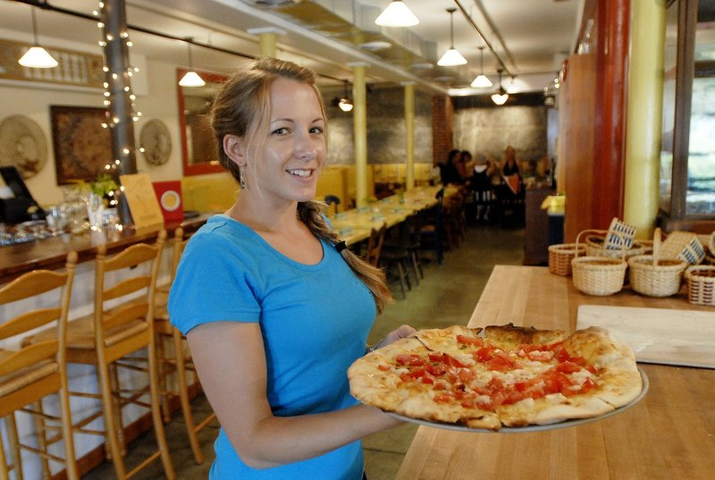 Holly Toothacker serves a pizza at Paolina's Way.