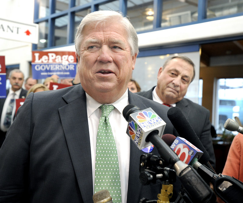 Mississippi Gov. Haley Barbour campaigns for Paul LePage, right, at DiMillo's Restaurant in Portland on Monday.