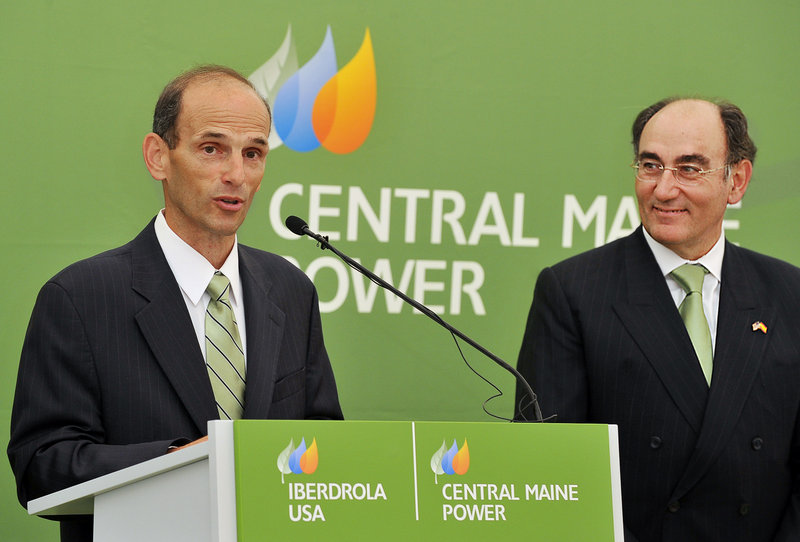 Gov. John Baldacci praises Iberdrola Group Chairman Ignacio Galan, right, for his company's commitment to Maine's power needs at a news conference Tuesday in Gorham.