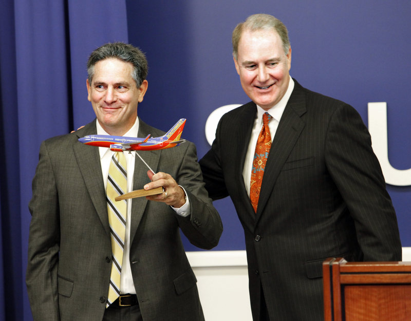 AirTran CEO Bob Fornaro, left, is seen with Southwest CEO Gary C. Kelly in Southwest's Dallas headquarters on Monday.