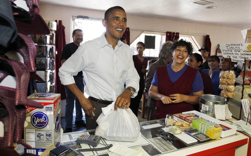 President Obama picks up Mexican food at Barelas Coffee House Tuesday in Albuquerque, N.M., one of several stops he has made as he works to rally Democrats for midterm elections.