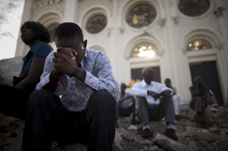 Catholics pray in the rubble of the Notre Dame cathedral during Mass in Port-au-Prince on Sunday. Haiti was devastated by a magnitude-7 earthquake on Jan. 12 that killed a government-estimated 300,000 people and left millions homeless.