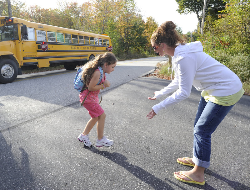 Liana Thoits meets her 5-year-old daughter Cadence Norris at her bus stop in Gray Wednesday. Thoits is angry that a bus driver dropped Cadence off by herself Monday.