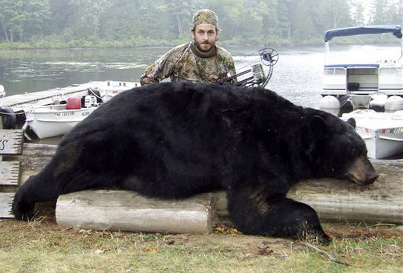 This Sept. 8 photo shows Dave Rizkallah of Derry, N.H., with a black bear weighing more than 600 pounds, which he shot and killed with a bow and arrow near Danforth, Maine. Wildlife officials say it was the second-largest bear taken in Maine.