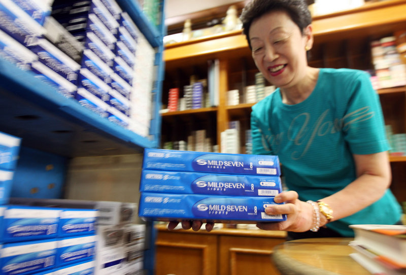 A sales clerk shelves cartons of cigarettes at a tobacco store in Tokyo, as many smokers across Japan anticipated a record 40 percent tax increase that takes effect Oct. 1. Japan is the world's fourth-largest market for cigarettes, behind China, the U.S. and Russia.